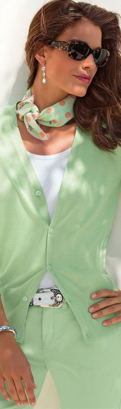 Pale green trousers of the same color cardigan and scarf
