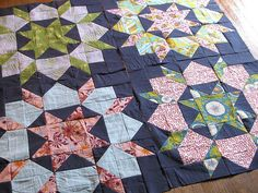 Dark background Swoon quilt- next on my list. Get a sewing machine! Did a lot of sewing when I was little. I want to attempt a quilt.