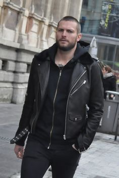 Black Perfecto style leather jacket and black hoodie