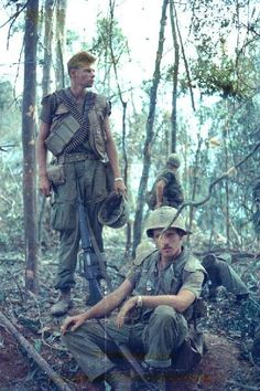 Two US Marines during Operation Scotland II. The one seated is a lieutenant and artillery forward observer, 1968 Source:facebook.com