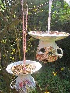 bird feeder made from fancy cups & saucers