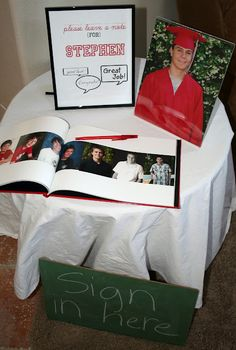 a photo book with space to sign-- cute idea for any milestone birthday party, not just graduation!