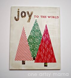 JOY canvas w/ modge podged scrapbook paper and stenciled letters