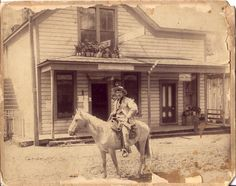 1800's Cowboy ~ I like the flower pots on the roof of the porch.