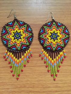A personal favorite from my Etsy shop https://www.etsy.com/listing/287087559/huichol-beaded-medallions-earrings