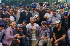 The team takes a group photo with the Stanley Cup.
