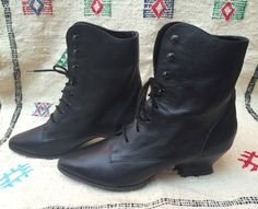 Perfect 80s does Victorian ankle boots. Soft black genuine leather. Low, curved heels. Dead stock. Never worn! By Ellemenno.  Marked size 7.5, these fit more like 6.5-7. Measurements in inches: Insole length 9.75 (keep pointy toes in mind) Ball of foot 3 Heel 2  Excellent condition