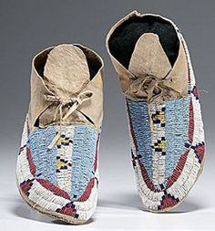 native american, America, Sioux beaded hide moccasins, sinew-sewn using glass bead colors of light blue, greasy yellow, red white-heart, white, and dark blue, circa 1900.