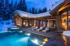 Located on a private mountainside estate, this beautiful Whistler, British Columbia, home offers spectacular views year-round. The home features rich wood beams throughout, and large windows to let in natural light. The five-and-a-half-acre estate includes a guesthouse, infinity-edge pool and several outdoor living areas.