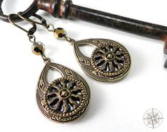 Victorian Earrings Antique Silver & Gold Mirror Button by Compass Rose Design. $48.50, via Etsy.
