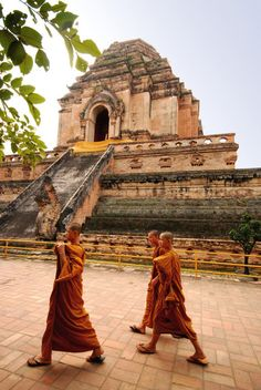 Buddhist monks at a temple ruin.