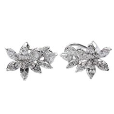 2.82 carats Marquise Diamond Cluster Earrings   From a unique collection of vintage clip-on earrings at http://www.1stdibs.com/jewelry/earrings/clip-on-earrings/