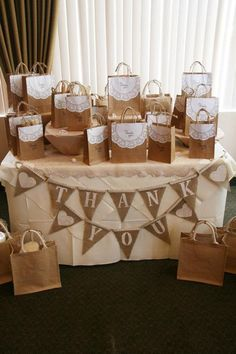 burlap and kraft paper thank your table decor / http://www.himisspuff.com/kraft-paper-wedding-decor-ideas/2/