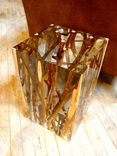 Acrylic and branches side table. There's also a silver painted tree trunk side table on this site that's interesting.