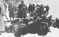 Ukrainian Auxiliary Police (with white bands) under the supervision of the Germans are preparing for the execution of Jews in Chernigov.