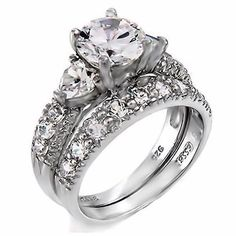 Check this moissanite flower engagement ring set from Camellia Jewelry. Scrupulously handmade in fine detail, it is a unique white gold ring set that will show her how much you care without breaking the bank. Wedding Rings Solitaire, Engagement Ring Settings, Bridal Rings, Vintage Engagement Rings, Vintage Rings, Wedding Bands, Wedding Venues, Wedding Vows, Solitaire Engagement