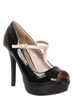These stiletto heels are strictly ballroom! The shiny patent faux leather finish of these shoes are reminiscent of sexy dance shoes, as is the contrasting tan t-strap across the top of the foot. Black Heels, High Heels, T Strap, Hot Topic, Stiletto Heels, Peep Toe, Dance Shoes, My Style, Leather