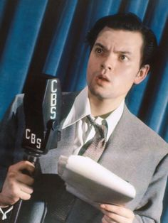 Orson Welles recreating his famous 'War of the Worlds' speech in the News color studio.