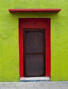 red door. green wall. | architecture