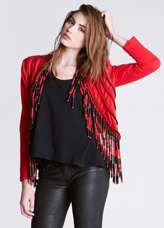 """Radical beaded fringe bolero style jacket with padded shoulders.  Condition: Excellent Label: Nooshin Marked Size: S Color: Red/Black Fabric: 100% Cotton Bust: 36"""" Waist: 36"""" Hips: 36"""" Length: 25"""" fringe included"""