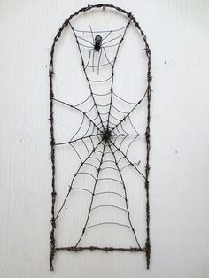 Spider In A Tattered Web Barbed Wire Garden por thedustyraven