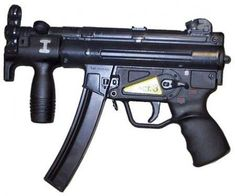 """HK MP-5K - original variant, with """"S-E-F"""" trigger unit and the standard 30-rounds MP-5 magazine."""