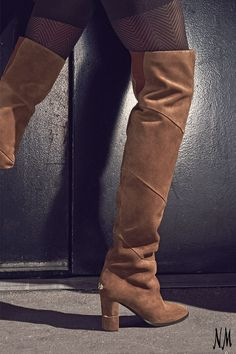 Embrace boot season with Jimmy Choo. Pair with tights and an A-line skirt for a chic cool-weather look.