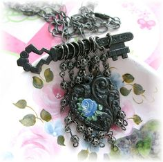 Rusty Black Patian Key Necklace Painted Blue Rose  by thevintageheart, via Flickr