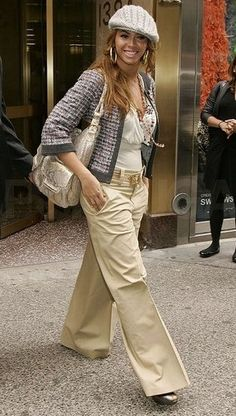 Tweed jacket + wide legged pants + low cut tank + pile of necklaces + knit hat