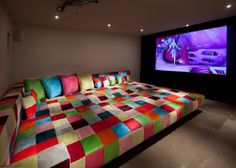 Giant Bed Style Seating Home Theater With Vibrant Color Scheme
