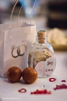 Something with the sand in a personalized Bottle from where beach you got Married on with something else attached