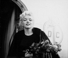 """Marilyn leaving New York to film """"Bus Stop"""" in Arizona, 15 March, 1956. Photo by Milton Greene."""