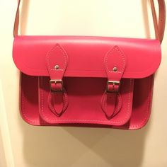 The Cambridge Satchel Company pink satchel Beautiful condition!! Like new, perfect purse for summer!! Has VERY light marking on the back, see last pic. 10.5x8. Real leather!! The outside has a pocket where the buckles are, the inside is just a plain leather without interior pockets. Madewell Bags Crossbody Bags