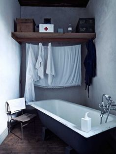 Love the 'red cross' box and the shelf in this bathroom