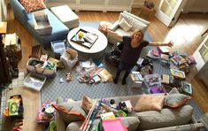 a person sitting on a cluttered table: Here's how one woman hired a professional organizer and completely changed her life (and how she thought about herself) to get organized and declutter. Handbag Organization, Organization Hacks, Organizing Ideas, Konmari Method, Filing System, Deck Chairs, Declutter Your Home, Best Handbags, Living At Home