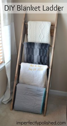 Ladder for Blankets in our Living Room! what a great way to store & display cute blankets we use :)