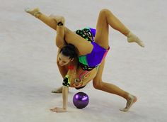 World Cup 2014 in Hungary | China's team perform their exercise | China's team perform their exercise with 3 balls and 2 ribbons at the team final. The team won gold in this team event.Picture: AFP/GETTY
