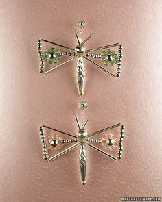 When making the dragonfly, refer to our illustration.    1. Make the body (see illustration A): Fold a 12-inch length of 24-gauge wire in half. Slide a 3 mm bead toward the folded end, followed by a long, thin bead. Add a 3 mm bead, a large twist bead, a 4 mm bead, a small teardrop bead, a 4 mm bead, a large teardrop bead, and a 4 mm bead. Add a 12 mm bead for the head.    2. Make the antennae: Push apart the two wire ends sticking out of the head