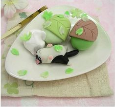 Japanese desserts featuring kitties! I believe it's mochi? The cat looks like my cat Boo so it's twice as cute.