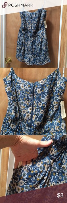 Blue floral romper with pockets & front zipper Feminine blue floral fully lined romper. NWT. Has pockets and zips up the front. Elasticized waist. Adjustable straps. EUC from a smoke free home. Forever 21 Shorts