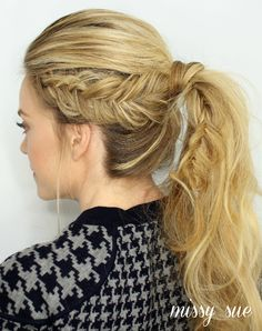 Dutch Fishtail Ponytail... I like that the braid doesn't start w/ the bangs.  makes it a little edgier.  not sure if i'd leave the braid in the ponytail part or take out the elastic