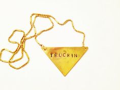 """Stamped Metal Triangle Pendant Necklace: Grateful Dead Song - """"Truckin"""""""