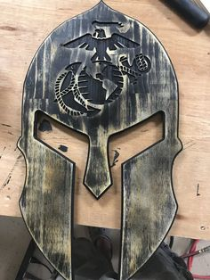 This USMC EGA Spartan Helmet Distressed Black is just one of the custom, handmade pieces you'll find in our wall décor shops. Wooden Projects, Wood Crafts, Spartanischer Helm, Escudo Viking, Spartan Helmet, Carved Wood Signs, Wood Flag, Got Wood, Military Gifts