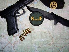 SoldF patch, knife, Glock 17, ammo and beret