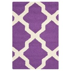 Perk up your space with a Safavieh Maison Textured Area Rug. This stylish rug makes a bold statement with a modern, oversized twist on the classic trellis pattern in bright purple and ivory. It's made of 100% wool with cotton backing to help keep it in place. Plus, it's tufted by hand for durability. At 4 x 6', this wool rug is ideal for smaller spaces. You can use it in an entryway, home office or small bedroom to bring your space to life.