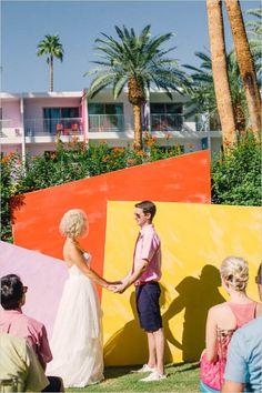 bright geometric ceremony backdrop for palm springs wedding #weddingceremony #destinationwedding #weddingchicks http://www.weddingchicks.com/2014/02/05/the-saguaro/