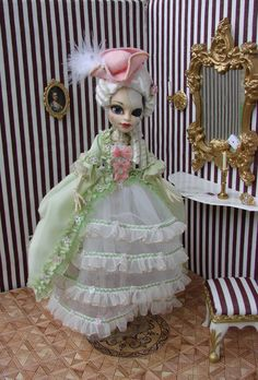 Customized Monster High doll Skelita (repainted face, removable wig from nylon rope,  rococo-inspired dress) in her boudoir, where neodymium magnets hold everything :-))