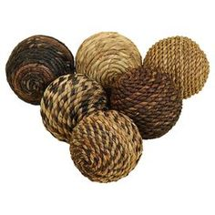 Bring rustic style to your d�cor with this eye-catching accent, an enviable addition to your well-appointed home.  Product: 6 Piece decorative ball setConstruction Material: Abaca weaveColor: MultiDimensions: 4 Diameter each