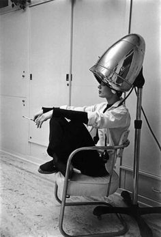 Mark Shaw, Photographed for LIFE in 1953, Audrey Hepburn, under the hair dryer, smokes a cigarette. While working on the film Sabrina, Audrey was shampooed every night and often conducted business with her agents while under the dryer