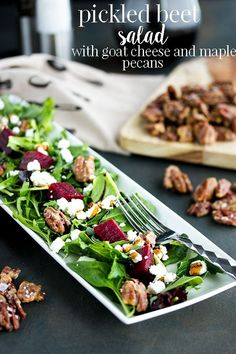 This pickled beet salad recipe with goat cheese is simple and addictive! With greens, pickled beets, goat cheese and homemade maple pecans, you will seriously impress guests with this salad's unique flavor and good looks. Beet Salad Recipes, Veggie Recipes, Lunch Recipes, Easy Dinner Recipes, Appetizer Recipes, Healthy Recipes, Easter Recipes, Healthy Meals, Healthy Food